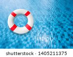 life buoy in a clear pool water.... | Shutterstock . vector #1405211375