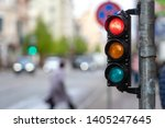Small photo of A city crossing with a semaphore. Red light in semaphore.