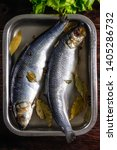 Stock photo salted herring in brine in a container on a wooden background 1405286732