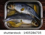Stock photo salted herring in brine in a container on a wooden background 1405286735