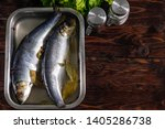 Stock photo salted herring in brine in a container on a wooden background 1405286738
