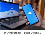 Small photo of CHIANG MAI, THAILAND - May.01,2019: Man holding Xiaomi Mi Mix 3 with OneDrive on screen. Microsoft OneDrive is a file hosting service that allows users to sync files.