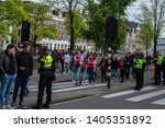police controlling crowd at... | Shutterstock . vector #1405351892