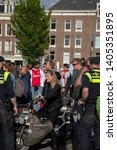 police controlling crowd at... | Shutterstock . vector #1405351895