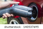 electric vehicle plugging in | Shutterstock . vector #140537695
