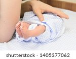 newborn baby in blue nappy on... | Shutterstock . vector #1405377062