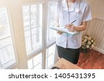 blur photo female doctor is... | Shutterstock . vector #1405431395