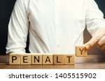 Small photo of A man puts a wooden blocks with the word Penalty. Fine as a punishment for a crime and offense. Violations of traffic laws. Legalized / financial punishment.