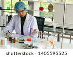 closeup asian female scientist... | Shutterstock . vector #1405595525