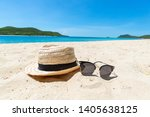 Straw Hat And Sunglasses On The ...