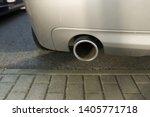 car exhaust pipe smoke fumes | Shutterstock . vector #1405771718