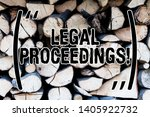 Small photo of Handwriting text Legal Proceedings. Concept meaning procedure instituted in a court of law to acquire benefit Background dry chopped firewood logs stacked up in a pile winter chimney.