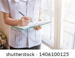 blur photo female doctor is... | Shutterstock . vector #1406100125