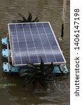 solar cell aerator in a pond | Shutterstock . vector #1406147198