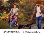 Stock photo professional man and woman dog walkers with group dog enjoying in park 1406393372