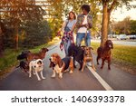 Stock photo happy woman and man dog walker with dogs enjoying in walk outdoors 1406393378