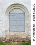 Old Gray Iron Door In Ancient...