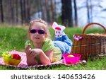 little girl with picnic basket... | Shutterstock . vector #140653426