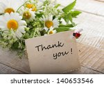wild flowers on wooden... | Shutterstock . vector #140653546