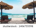Small photo of Two chaise lounges and straw umbrella on tropical beach. Coast of island Koh Rong Samloem, Cambodia. free empty copy space for text
