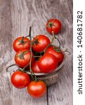 Cherry Tomatoes On Wooden Tabl...