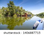 traveling by boat through the... | Shutterstock . vector #1406887715