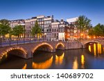 Stock photo pretty dutch doll houses illuminated and reflected along the tranquil canals of amsterdam 140689702