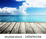 caribbean sea and wooden... | Shutterstock . vector #140696146