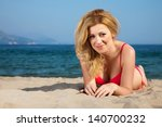 attractive woman on a seacoast | Shutterstock . vector #140700232