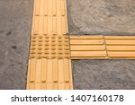 bright yellow tactile paving... | Shutterstock . vector #1407160178