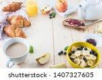 breakfast on a wooden simple... | Shutterstock . vector #1407327605