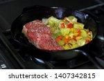 new york strip steak frying in...