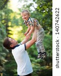 happy father and his baby son... | Shutterstock . vector #140742622