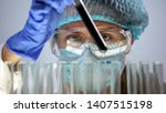 chemical lab worker holding... | Shutterstock . vector #1407515198