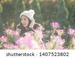 portrait of happy asian young... | Shutterstock . vector #1407523802