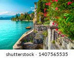 Picturesque landscape with lake and mediterranean buildings. Fresh oleander flowers and beautiful ornamental garden with villa Melzi, lake Como, Varenna, Lombardy region, Italy, Europe