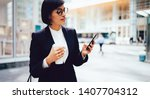 young brunette woman reading... | Shutterstock . vector #1407704312