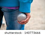 Boule ball in the hand of a woman - stock photo