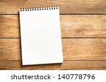 Blank Notepad On A Wooden...