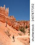 beautiful desert scenery. man... | Shutterstock . vector #1407877352