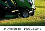green lawn mower tractor....   Shutterstock . vector #1408031048