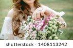 the bride touch her flower... | Shutterstock . vector #1408113242