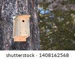 wooden birdhouse mounted on a...   Shutterstock . vector #1408162568