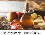 apple vinegar. bottle of apple... | Shutterstock . vector #1408360178
