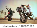 Moto Riders Making A Stunt On...