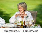 happy senior woman with hands... | Shutterstock . vector #140839732