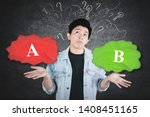 Small photo of Confused young man choosing option A or option B with chaotic symbol background
