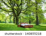 bed in a forest- concept of good sleep