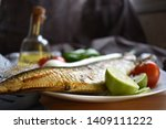 Stock photo mediterranean food smoked herring fish served with green onion lemon tomatoes green pepper olive 1409111222