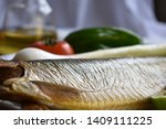 Stock photo mediterranean food smoked herring fish served with green onion lemon tomatoes green pepper olive 1409111225